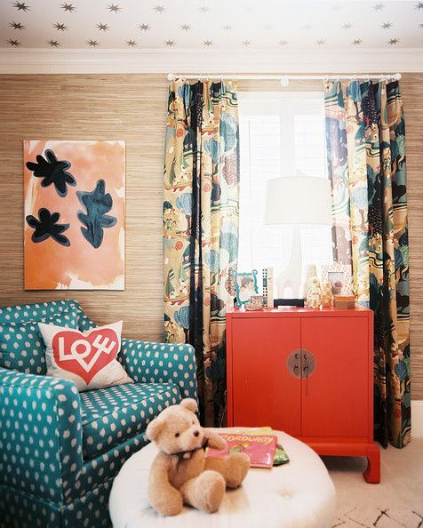 A colorful eclectic nursery which will be stimulating for baby but a pleasant grown-up space for adults. I love how the art ties the orange accent together and mimics the curtains; a childlike space that's not childish!