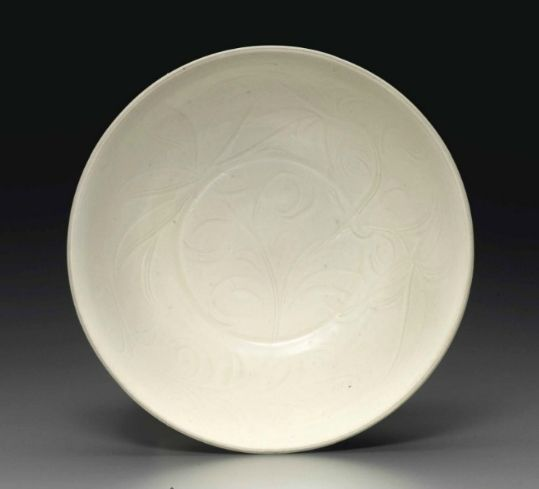 A rare Dingyao incised 'Daylily' deep bowl, Northern Song dynasty, 11th-12th century