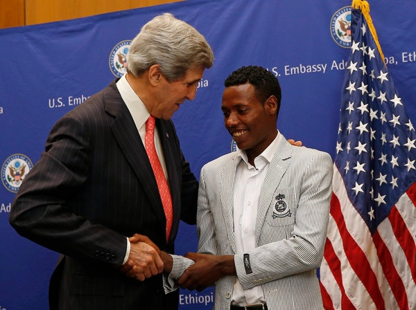 "Winner of the Boston Marathon, Oromo athlete Lelisa Desisa with United States Secretary of State John Kerry at the American Embassy in Oromian Capital, Finfinnee. In a somber ceremony at the American Embassy on Sunday, 26th May 2013,  Lelisa Desisa, the men's winner of this year's Boston Marathon, said he intended to donate his medal to the people of Boston.  ""Sport holds the power to unify people,"" Desisa said."