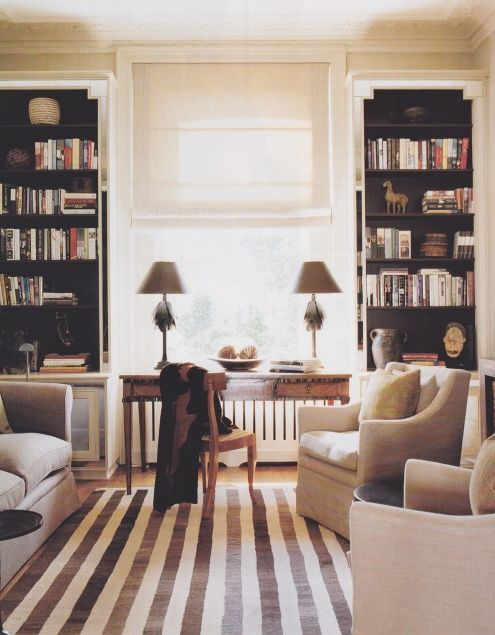 Living room/ study w/ stripe carpet and black built ins http://dreamstodiggs.tumblr.com/page/3