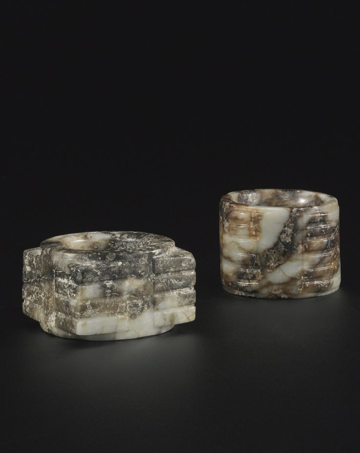 Two archaistic jade cong