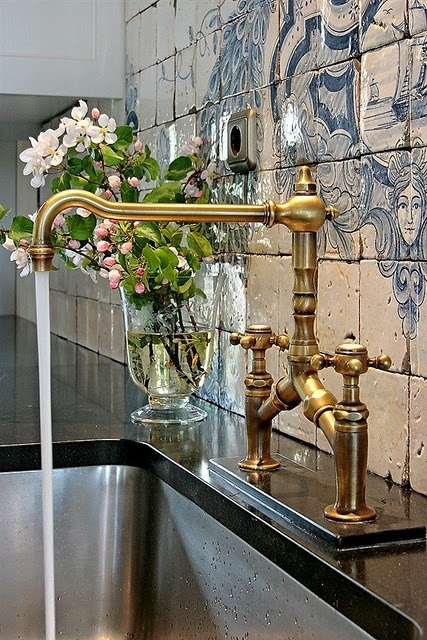 Stunning Brass Faucet and Tile Backsplash