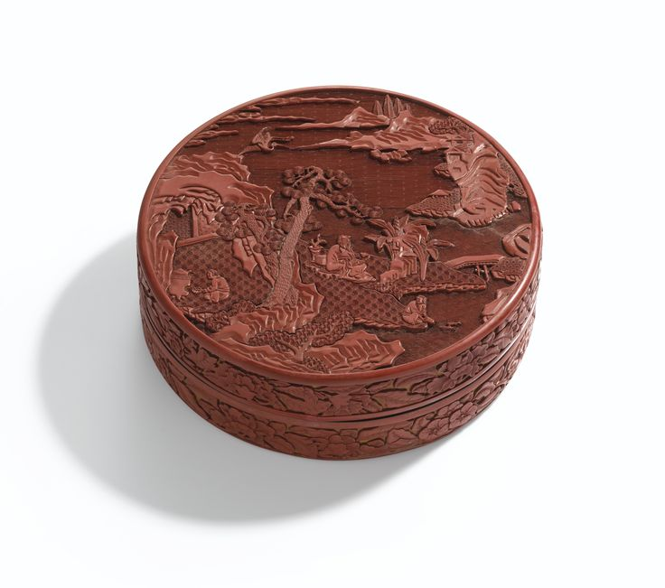 A carved cinnabar lacquer circular box and cover, 17th century
