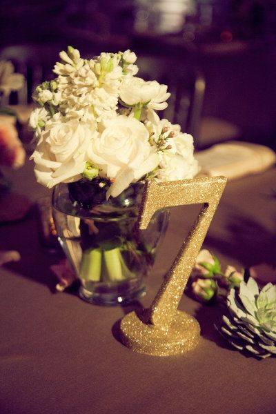 glittery table numbers in gold | wedding decor and table settings