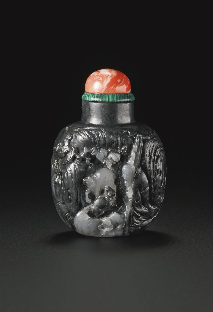 A black and white jade 'Goatherd' snuff bottle, Suzhou School, Qing dynasty, mid-18th-mid-19th century