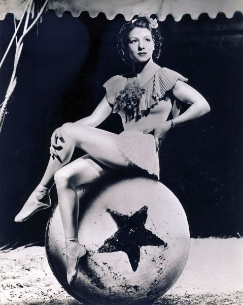 Antoinette Concello, trapeze artist, poses for publicity photo.  By William Woodcock.