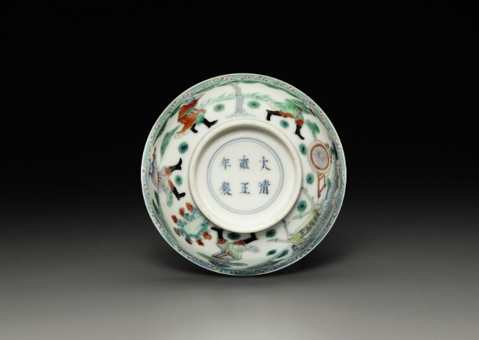 A small doucai 'Tribute Bearers' bowl, Yongzheng six-character mark in underglaze-blue within a double circle and of the period (1723-1735)