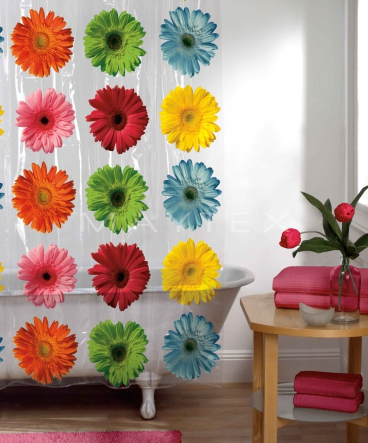 Colorful shower curtains liven up a grown up bathroom for the little ones without costing a fortune