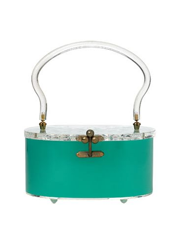 This Lucite purse was made in the 1950s by Charles S. Kahn, a Miami, Florida-based manufacturer whose showstopping bags were often designed with a solid metallic color and spun silk-like finish. Plastic handbags designed by Kahn are often identifiable by a distinctive clasp, which features three metal balls. Kahn's paper labels were placed inside the purse below the hinge of the lid.
