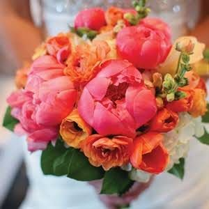 bouquet of coral peonies and orange tulips, snapdragons and ranunculus.