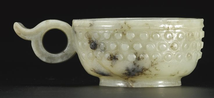 AN ARCHAISTIC GRAYISH-GREEN JADE ONE-HANDLED CUP<br>17TH CENTURY | Lot | Sotheby's