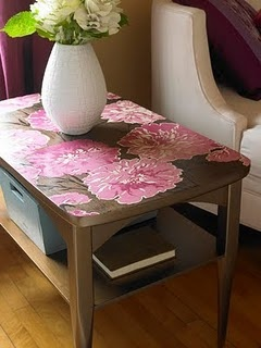 Use wallpaper and mod podge to cover scratches or stains on an old coffee table.
