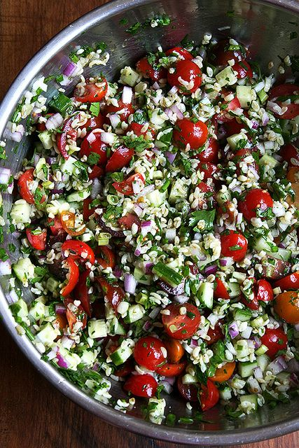 1 cup bulgur, extra-coarse* if possible 1 red onion (to yield about a cup when finely diced) 5 to 6 scallions 1 small bunch of chives  1 English cucumber  1 to 2 cups cherry tomatoes  1 bunch parsley  mint (yield 1/4 cup minced)  1/4 cup extra-virgin olive oil  2 to 3 lemons, juiced about 1/4 cup  kosher salt and freshly cracked black pepper