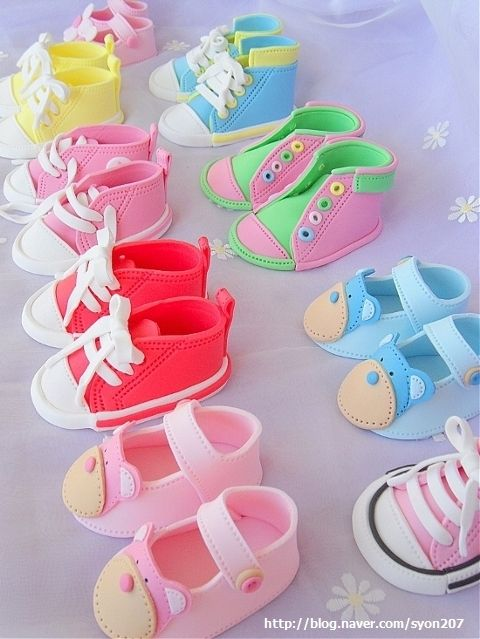 Excellent step-by-step photo tutorial: How to make fondant baby converse shoes ... (would be fun to do in polymer clay too!)