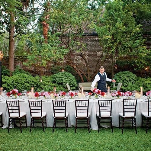 An Elegant Garden Party | those hanging lights + bright flower arrangements!