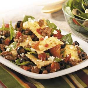 Greek-Style Ravioli Recipe.  Add kalamata olives, reduce meat from whole package, add more greek seasoning