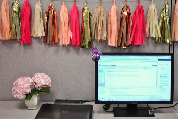 Hang a Tassel Garland in your cubical or office space.  Photo compliments of  http://www.quietlikehorses.com