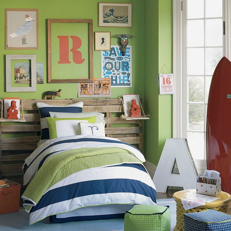Green is the main theme in this 'Little Boy's Playground' bedroom. A wood pallet is cleverly used as the headboard.