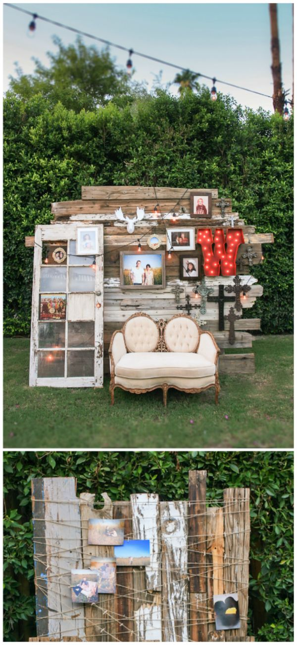 Reclaimed wood photo backdrop designed with the couples pictures, cross collection and old lit sign.  www.arrangementsdesign.com