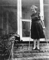 Flannery O'Connor with one of her many beloved peacocks