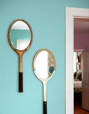 Vintage tennis rackets as creative wall mirrors.