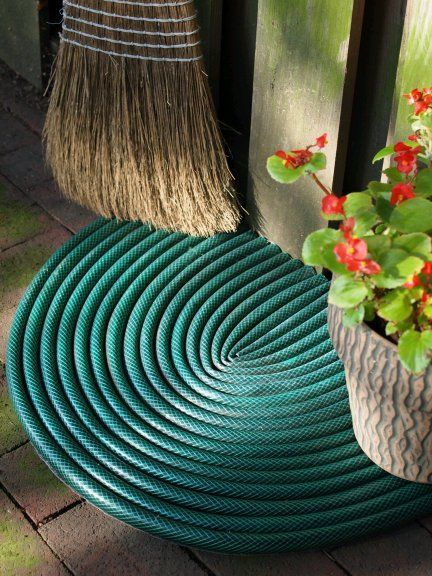 Upcycled garden hose door mat by Mark Kintzel (Dishfunctional Designs)