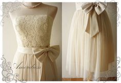 Who wouldn't want such a beautiful cream dress?! Love the way the tulle hangs below the skirt!!