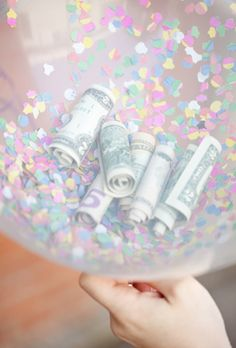 Money Balloons - fill with rolled up bills and confetti....a cool way to present money as a gift, esp for a young person -I Love the 2 dollar balloons.