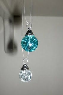 Bake marbles at 325/350 for 20 min. Put in ice water to make them crack on the inside. Glue end caps to them with starter rings to create pretty pendants!