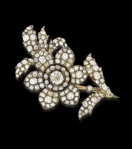 An early 19th century diamond flower brooch
