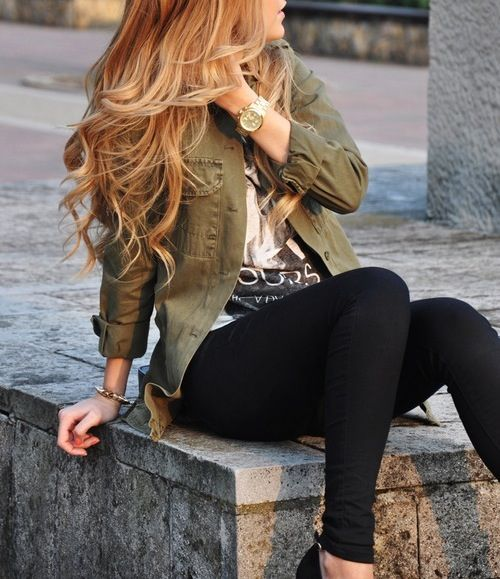 Army green jacket, graphic b&w tee with black pants