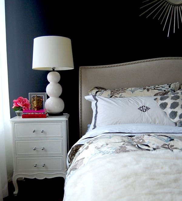 bedroom - black's a little too dramatic for me but i love the mirror and headboard! pink flower is a cute accent too. :)