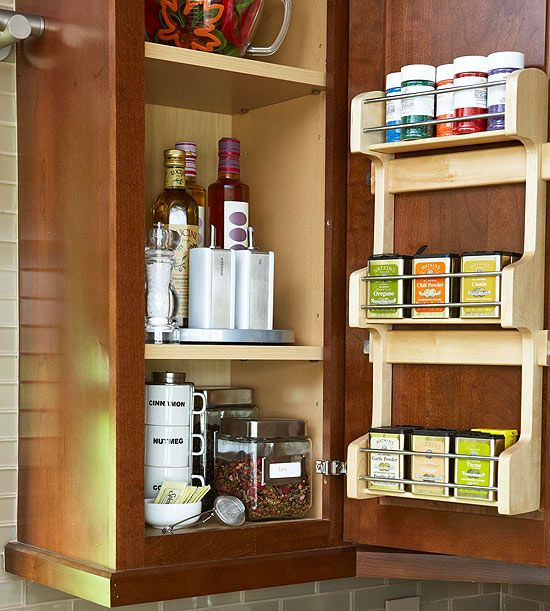 The inside of cabinet doors makes a convenient place for a small spice rack. See more kitchen storage ideas: http://www.bhg.com/kitchen/storage/organization/new-kitchen-storage-ideas/?socsrc=bhgpin022413spicerack=19