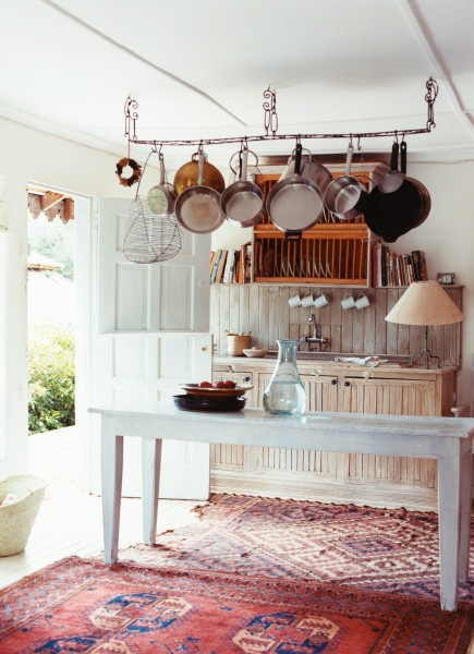 Farmhouse kitchen with Turkish rugs. Image by Paul Costello