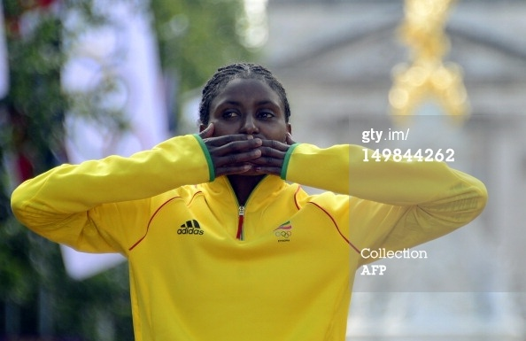News Photo: Gold medalist, an Oromo, Tiki Gelana blows a kiss…