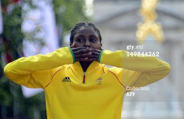 News Photo: Gold medalist, an Oromo, Tiki Gelana blows a kiss…
