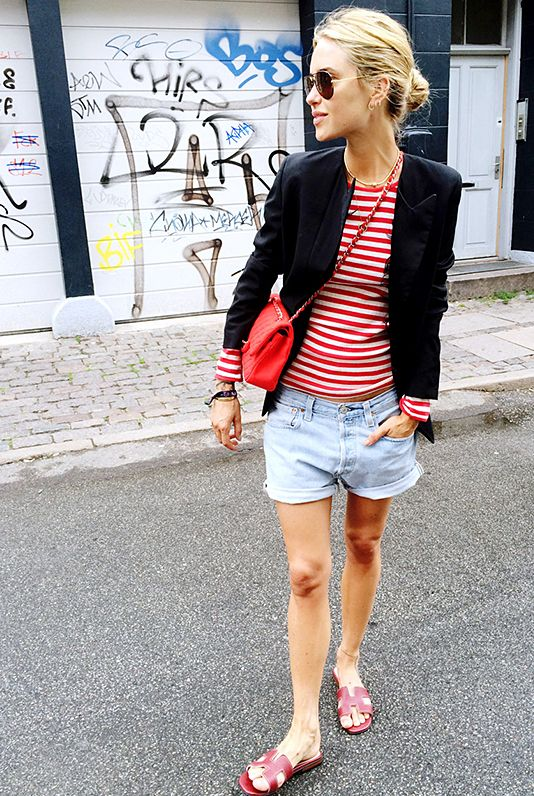 Pernille Teisbaek of Look De Pernille wears a red and white striped shirt with denim shorts and a blazer for an effortless #streetstyle look.