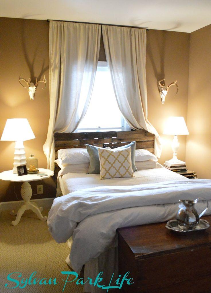 Guest Bedroom: Bed in front of window
