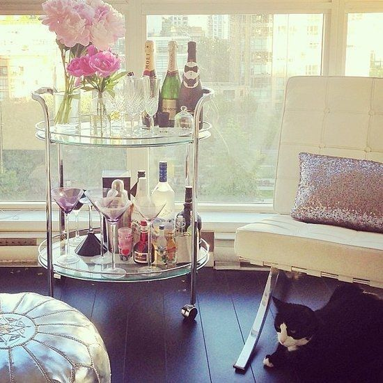 Does it get any better than this sequin pillow, adorable bar cart (with peonies too!) and glam Moroccan pouf? We can't imagine it does.