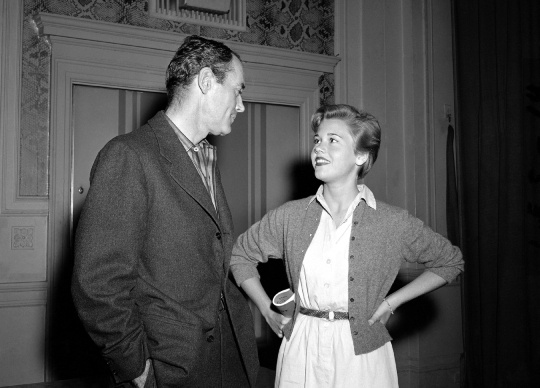 "Veteran stage and screen star Henry Fonda and his 17-year-old daughter, Jane, take a break during rehearsals for the Omaha Community Playhouse production of ""The Country Girl,"" June 18, 1955, in which Fonda co-starred with Dorothy McGuire. Jane won the ingenue role in a telephone audition with Playhouse director Kendrick Wilson."