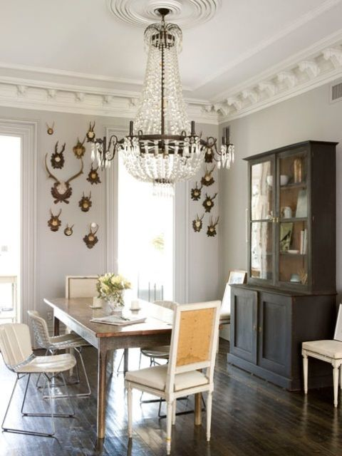 regal dining room with nice chandelier and great mix of chairs