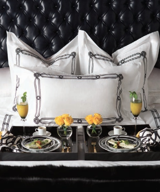 Raised headboard, classically simple pillows -  ready for breakfast in bed