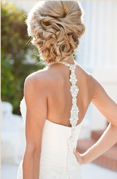 Intricate knotted and curly updo wedding hairstyle on earlyivy.wordpress.com