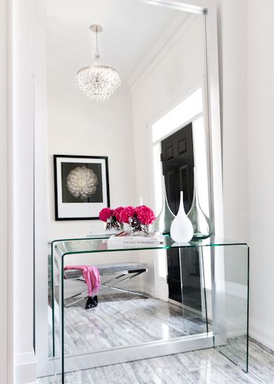 Niche in a small space? Foyer? Instead of the ol' console table with mirror, a floor to nearly-ceiling leaning mirror behind. Brilliant.