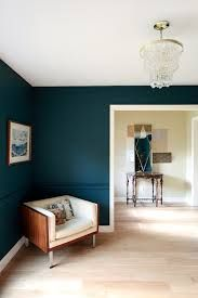 color perfection. i love how the wood and whites pop against the teal. Benjamin Moore Dark Harbor, mixed 25% darker.