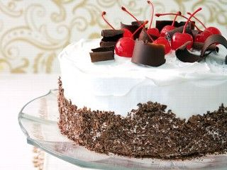 Black Forest Cake  Ingredients  1 (18.25-ounce) box super moist chocolate fudge cake mix, Betty Crocker  1 2/3 cups chocolate milk  1/2 cup vegetable oil  3 large eggs  3 tablespoons unsweetened cocoa powder  3/4 cup cherry pie filling  1 (12-ounce) container frozen nondairy whipped topping, thawed  Garnish: 1 (9.7-ounce) bar bittersweet dark chocolate  Maraschino cherries    Cooking Directions    http://abcnews.go.com/GMA/recipe/black-forest-cake-9390019    http://coffeeandpoems.com