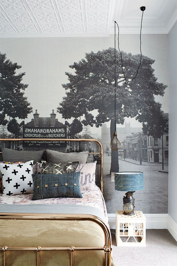 "bedroom with an amazing feature wall mural created from a vintage photo of the area, gold bed frame, milk crate used as a side table... A group of friends (who call themselves ""A Gentleman's Agreement"") decided to buy this dilapidated house and transform it (styling by Jane Frosh from Cool Edie's, photography by Phu Tang via @insideoutpins )"