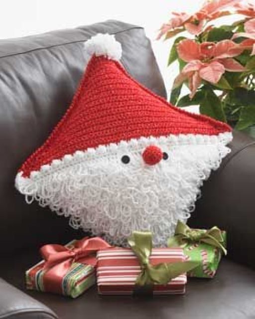 Santa pillow is so-ho-ho cute. Crochet a Claus for someone you love. (Bernat)