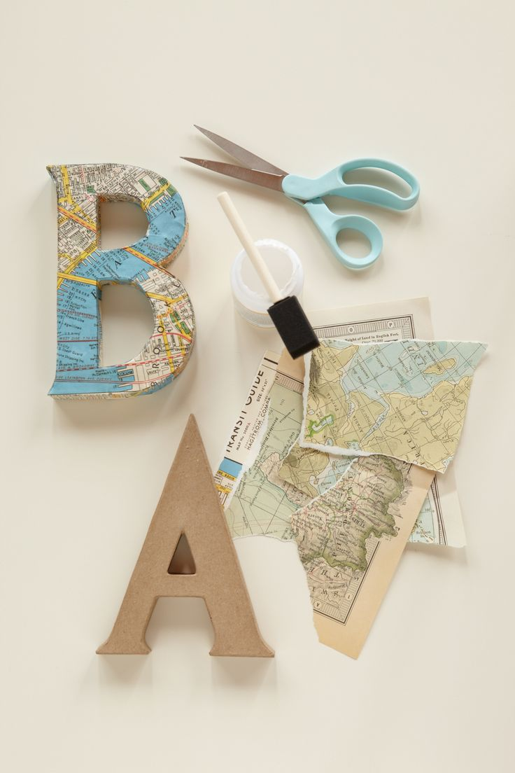 "Decoupage Letters. Use vintage maps and cut out letters to spell out ""baby"" or the baby's name for the backdrop to your baby shower."