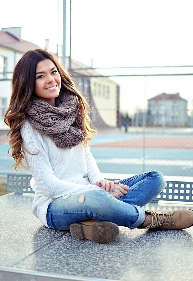 I love her outfit ---White sweater, ripped jeans, boots, chunky-knit taupe infinity scarf